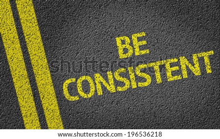 Be Consistent written on the road - stock photo
