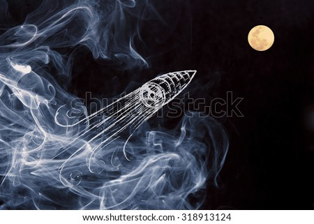 Be creative on your start up project composition with hand drawn space ship launch over night moon sky with smoke background. - stock photo
