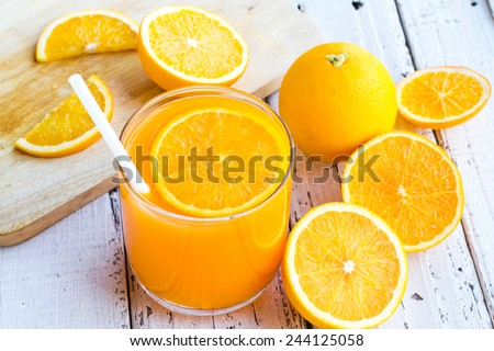 Be cut to remove the orange juice to drink and eat and be healthy. - stock photo