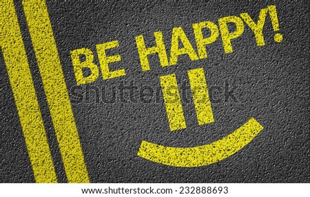 Be Happy with a Happy Smiley written on the road