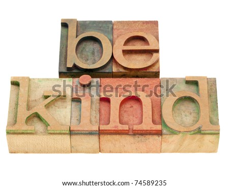 be kind motivational reminder - phrase in vintage wood letterpress type, stained by color inks, isolated on white