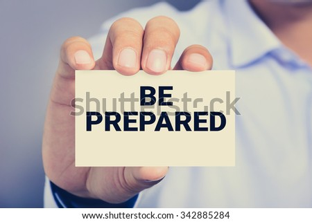 BE PREPARED, message on business card shown by a man, vintage tone - stock photo