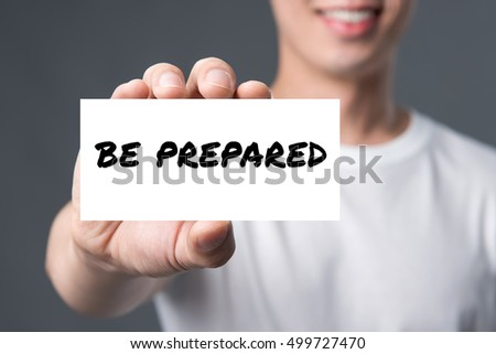 BE PREPARED, message on the card shown by a man
