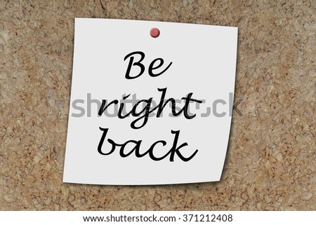 Be right back written on a memo pinned on a cork board - stock photo