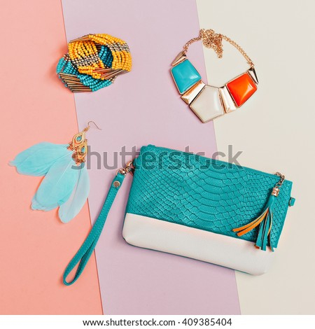 Be stylish. Fashionable Lady's Accessories. Necklaces, Bracelets, Earrings, Clutch. Detail Fashion - stock photo