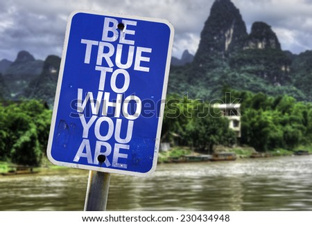 Be True To Who You Are sign with a forest background - stock photo