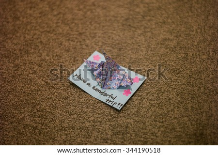 "be welcome card. Welcome card to tourist background with origami dove from Paper craft Japanese style  with word  ""Have a wonderful trip""  - stock photo"