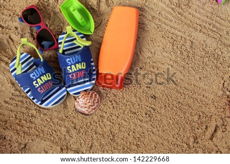 Beach accessories for little traveler - stock photo