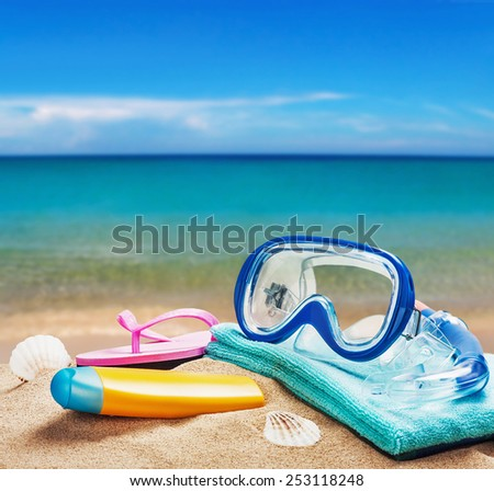 beach accessories for relaxing on the sand on the sea background - stock photo