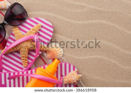 Beach accessories for the beach lying on the sand, with place for your text - stock photo