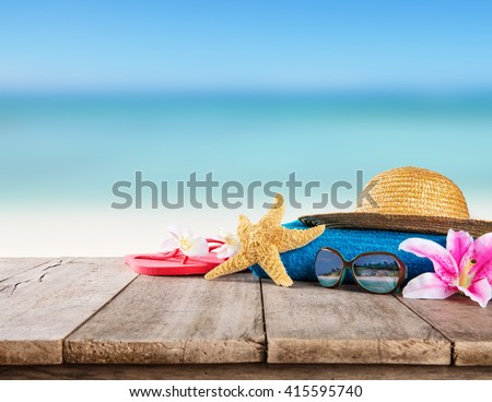 Beach accessories for travelling on wood - stock photo