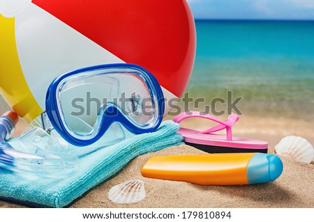 beach accessories on a background of sea and sand - stock photo