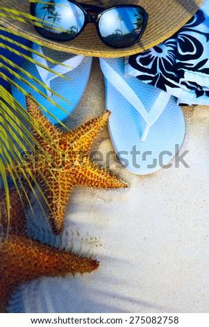beach accessories on a deserted  tropical beach - stock photo