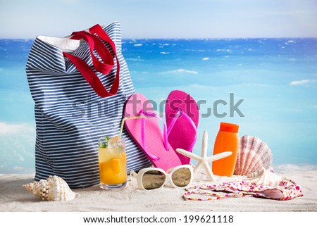 Beach accessories on a summer beach - beautiful concept - stock photo