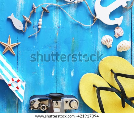 Beach accessories on blue wooden background - stock photo