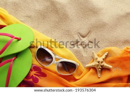 Beach accessories on sand beach - stock photo