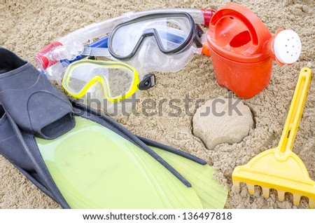 Beach accessories on sand. Concept of summertime. - stock photo