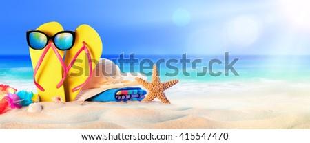 Beach Accessories On Seashore - Summer Holidays  - stock photo