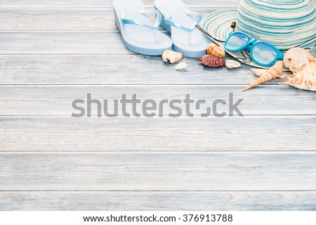 Beach accessories on wooden board. Concept of the summer time.