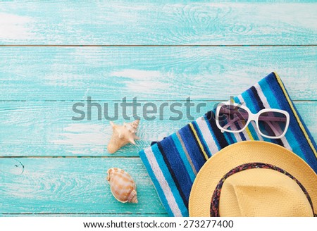 beach accessories on wooden board copy spase - stock photo