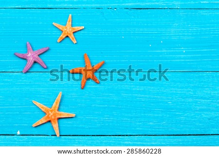 beach accessories on wooden board. studio shot - stock photo
