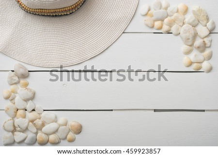 Beach accessories on wooden board. Summer vacation