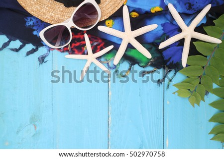 beach accessories on wooden board,travel concept