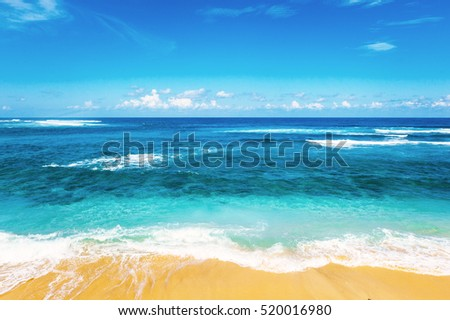 Beach and beautiful tropical sea. Caribbean summer sea with blue water. White clouds on a blue sky over summer sea. Tropical sea relax.