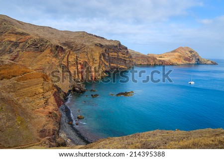 Beach and blue ocean water bay on coast of Madeira island, Portugal