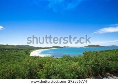 Beach and blue sea in green island  - stock photo
