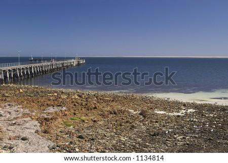 Beach and Jetty - stock photo