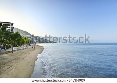 Beach and Malecon on Pacific Ocean in Puerto Vallarta, Mexico - stock photo