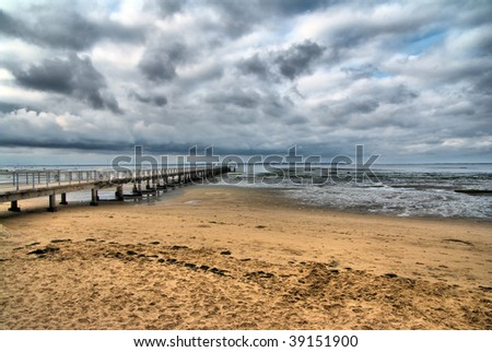Beach and pier in an upcoming storm