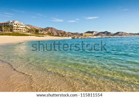 Beach and resorts on the sandy beach coastline of Cabo San Lucas, Mexico - stock photo
