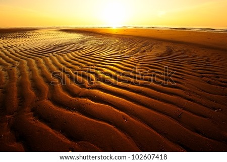 Beach and Sand Pattern at Sunrise Background - stock photo