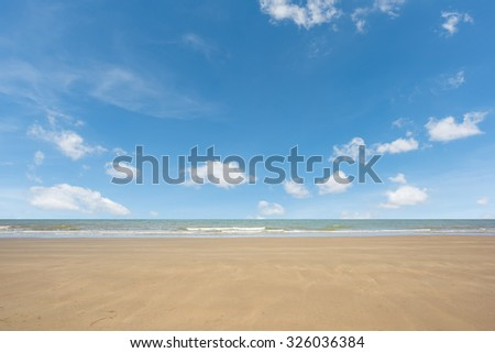 beach and sea with blue sky - stock photo