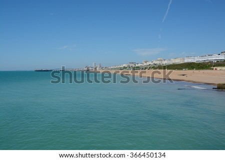 Beach and seafront at Brighton, East Sussex, England. Viewed from Marina. - stock photo