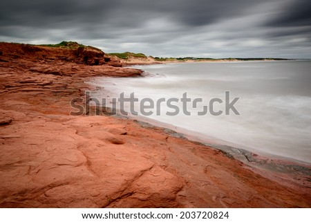 Beach and shore as hurricane winds drive offshore - stock photo