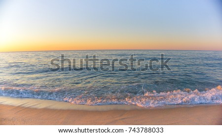 Beach and sky during sunset.