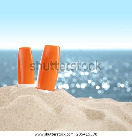 beach and suntan oil  - stock photo