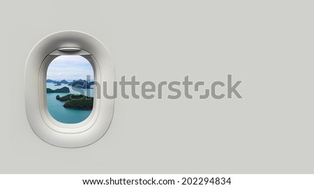 beach and tropical sea at Airplane window and place for text - stock photo