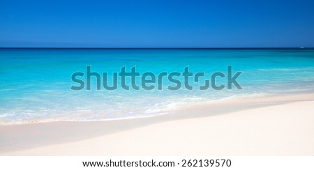 beach and tropical sea, blue sky and turquoise water - stock photo