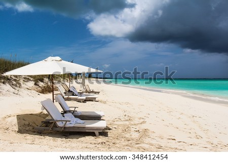 Beach and umbrellas during a approaching storm - stock photo