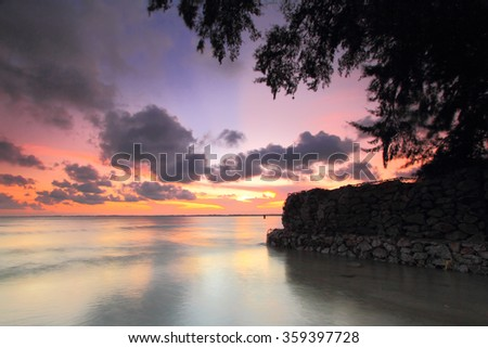 Beach and wave on sunset,Soft focus because of slow shutter speed - stock photo