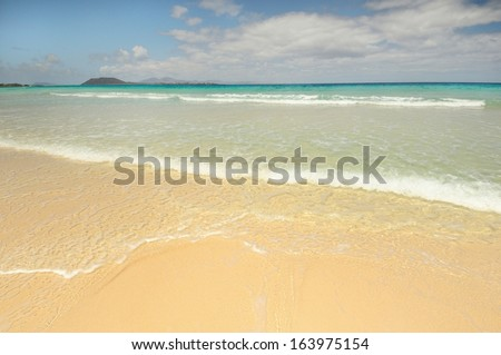 Beach at Corralejo, Fuerteventura Island. Isla de Lobos in the background. - stock photo