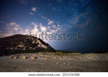 beach at night under the stars and the tail of the Milky Way - stock photo