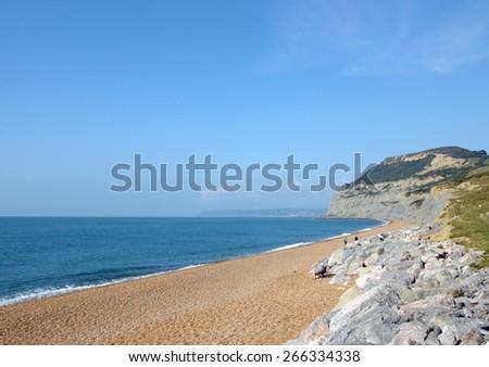 Beach at Seatown beneath Golden Cap on Dorset coast - stock photo
