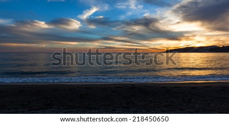 Beach at sunset in Almunecar, Costa del Sol, Spain