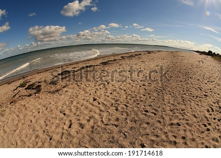 beach at the german island Hiddensee, baltic sea, taken with fish-eye lens - stock photo