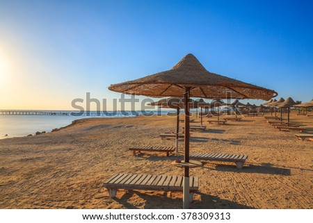 Beach at the sea with the umbrellas